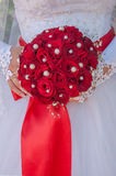 Wedding bouquet with roses. Wedding bouquet with red roses in hand of the bride Royalty Free Stock Images