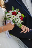 Wedding bouquet with roses. Wedding bouquet with red roses in hand of the bride Stock Images