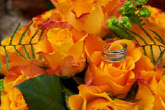 Wedding bouquet with roses. And rings Stock Image
