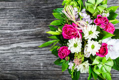 Wedding bouquet with roses and white gerberas on an old wooden table Royalty Free Stock Photography