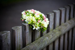 Wedding bouquet on rustic country fence Stock Photo