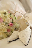 Wedding bouquet & shoes Stock Image