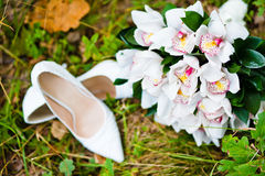 Wedding bouquet with shoes Royalty Free Stock Image