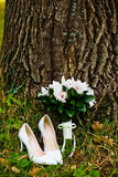 Wedding bouquet with shoes Stock Photography