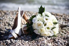 Wedding bouquet and shoes Royalty Free Stock Images