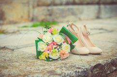 Wedding bouquet and shoes, details of the wedding, wedding, groom, bride. Wedding bouquet and shoes, details and accessories of wedding, wedding, groom, bride Royalty Free Stock Photo