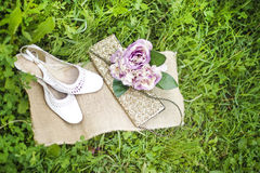 Wedding bouquet and shoes. Wedding shoes and wedding bouquet in the grass Royalty Free Stock Photo