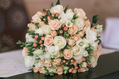 Wedding bouquet of small white and pastel pink roses and berries. Wedding bouquet of small white and pastel pink roses and berries Royalty Free Stock Photography