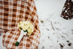 Wedding bouquet on the snow Royalty Free Stock Photo