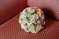Wedding bouquet on sofa Royalty Free Stock Photo