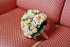 Wedding bouquet on sofa Stock Image