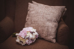 Wedding bouquet on a sofa. Royalty Free Stock Image
