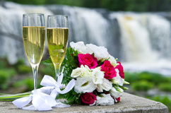 Wedding bouquet and sparkling wine Stock Photos