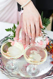 Bouquet and sparkling wine in glasses Royalty Free Stock Photo