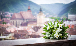Wedding bouquet spring flowers with Brasov city view panoramic Stock Photo