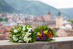 Wedding bouquet spring flowers with panoramic Brasov city view Stock Photos