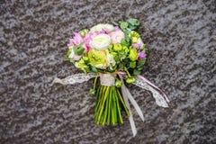 Wedding bouquet on stone background. Beautiful pink wedding bouquet on stone background. Top view Stock Image