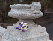 Wedding bouquet on a stone pot in the park Stock Photos