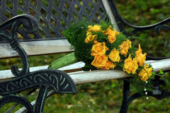 Wedding bouquet on stylish bench. Wedding roses bouquet with pearls on stylish bench (outdoor Royalty Free Stock Image