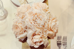 Wedding bouquet on table. Wedding bouquet on a wedding table Royalty Free Stock Photo