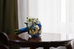 Wedding bouquet table. Near window Stock Photography
