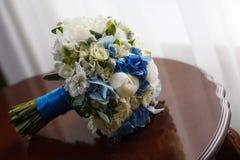 Wedding bouquet table. Near window Stock Photos