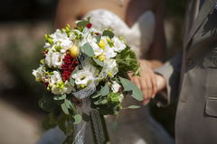 Wedding bouquet of tender tones in the hands of the newlyweds Royalty Free Stock Photos