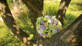 Wedding Bouquet Tied With Ribbons to the Swings Under the Tree. HD stock video