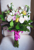 Wedding bouquet tied with silk ribbons Stock Image