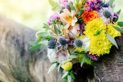 Wedding bouquet on tree. At green summer wood Stock Photo