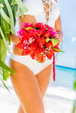 Wedding bouquet from tropical flowers in bride's hans on n Royalty Free Stock Images