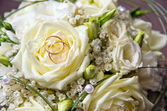 Wedding bouquet with two rings Stock Photos