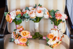 Wedding bouquet on vintage beige chair, peach and white roses Royalty Free Stock Photography