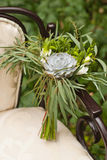 Wedding bouquet at vintage chair Royalty Free Stock Photo