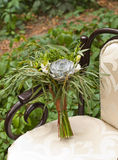 Wedding bouquet at vintage chair Royalty Free Stock Photography