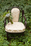 Wedding bouquet at vintage chair Stock Image