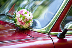 The Wedding bouquet on vintage wedding car Royalty Free Stock Photo