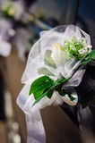 Wedding bouquet on vintage wedding car Stock Images