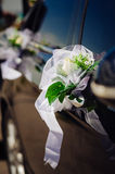 Wedding bouquet on vintage wedding car Royalty Free Stock Photos