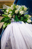 Wedding bouquet on vintage wedding car Royalty Free Stock Images