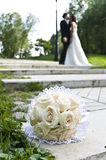 Wedding bouquet with the wedding couple Stock Photos