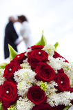 Wedding bouquet with wedding couple Royalty Free Stock Photos