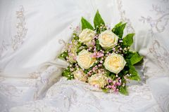 Wedding bouquet on wedding dress Royalty Free Stock Image