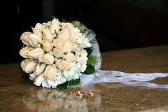 Wedding bouquet, wedding rings. Stock Image