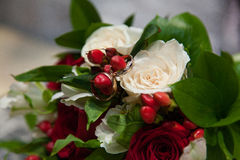 Wedding bouquet with wedding rings. Royalty Free Stock Image