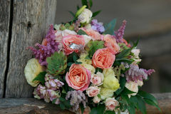 Wedding bouquet and wedding rings Stock Photo