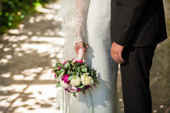 Wedding bouquet. Weddings bouquet in the bride and groom hands royalty free stock photography