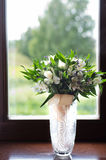 Wedding bouquet of white Alstroemeria. Is in the vase at the window Stock Image