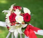 Wedding bouquet with white and red roses on green background Stock Photography