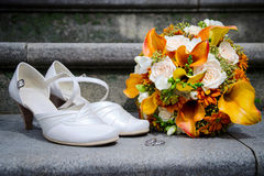 Wedding bouquet, white bride's shoes and rings Stock Images